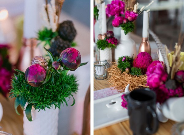 bright pink flowers in ceramic vases and faux woven nest