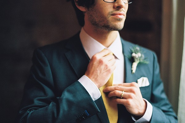 Groom with grey suit and yellow tie from mywedding magazine photo by Kate Ignatowski