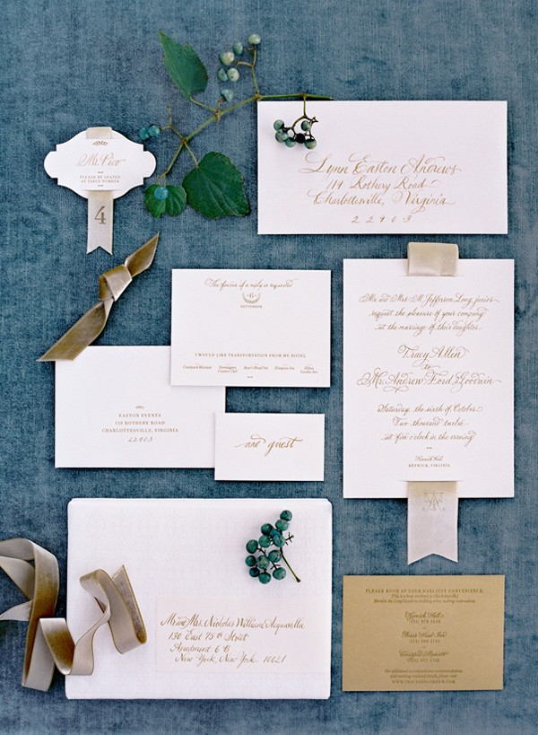 Neutral wedding invitations in calligraphy with ribbon