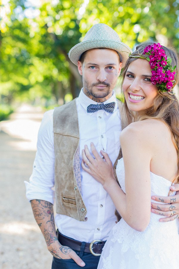 boho bride with pink flower crown and hipster groom in bow tie and vest