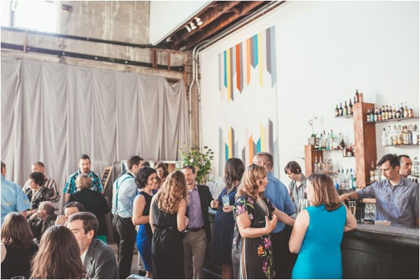 reception guests at modern wedding in industrial venue