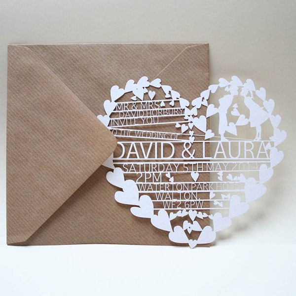 paper nheart cut out as modern wedding invitation
