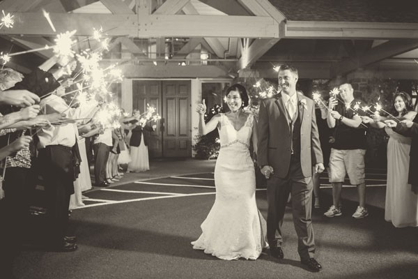 bride gives thumbs up during sparkler exit