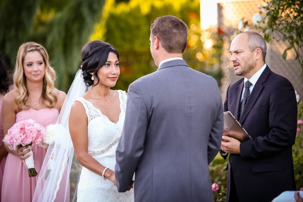 bride looks up at groom during their vows