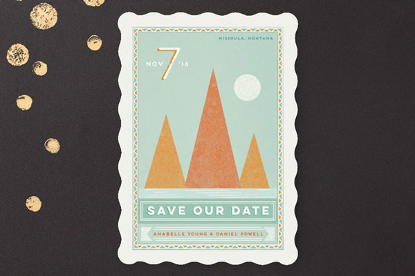 save the date card with illustrated mountains