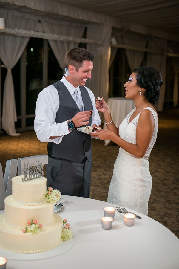 bride and groom cut the buttercream wedding cake