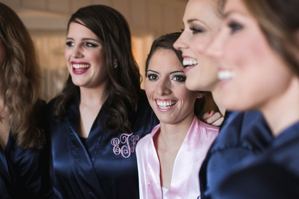 bride with bridesmaids in satin robes with monogram
