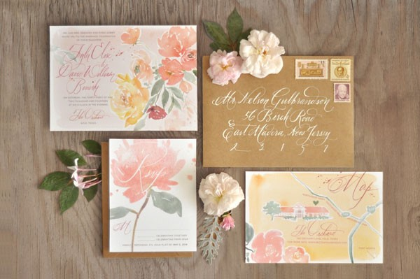 watercolor wedding invitation with painted flowers in pinks and yellows