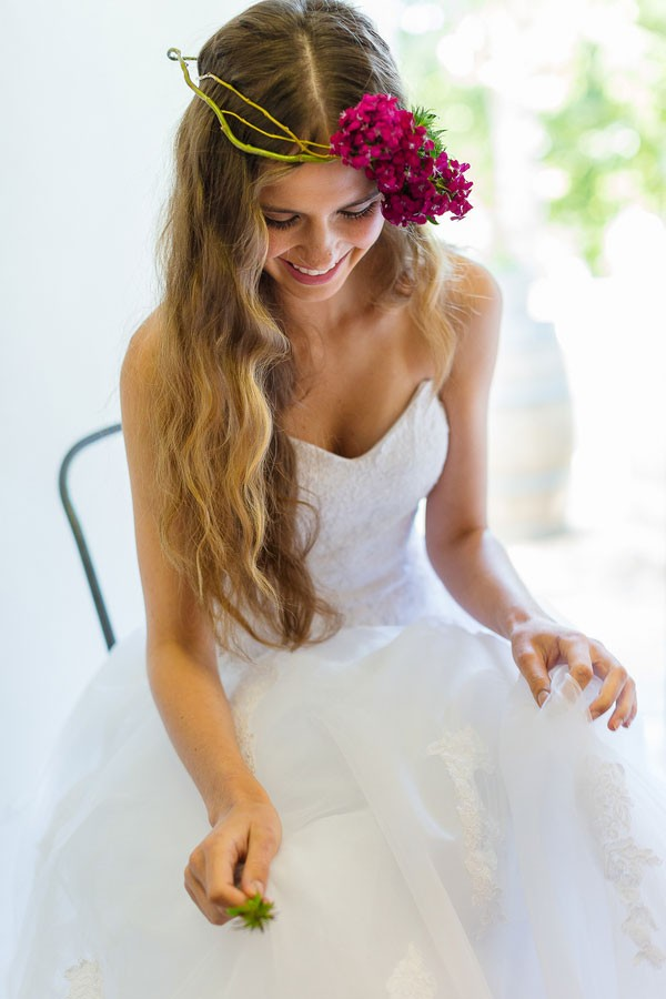 boho bride in simple dress with long hair and floral crown