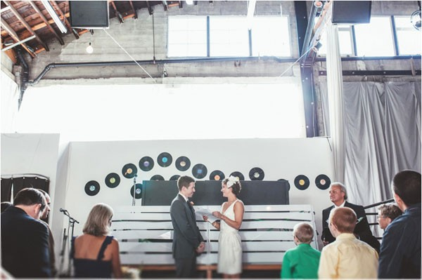 modern wedding backdrop made of vinyl records against wall