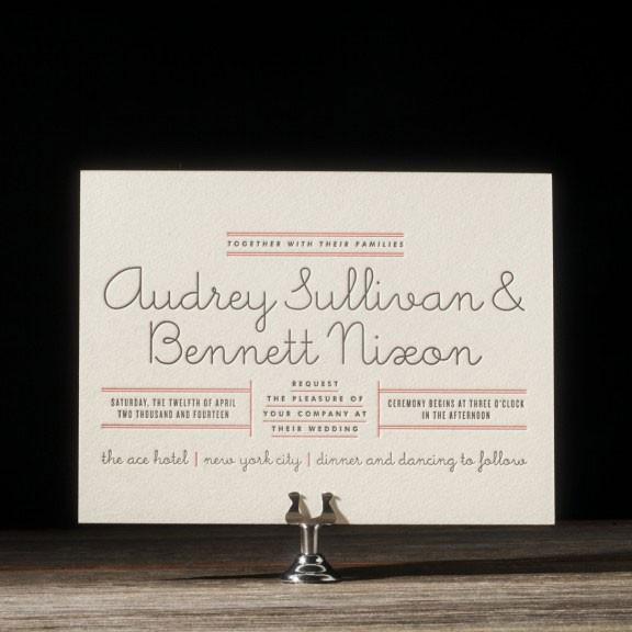 letterpress wedding invitation with retro cursive font
