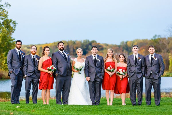 bridesmaids and groomsmen with couple by lake