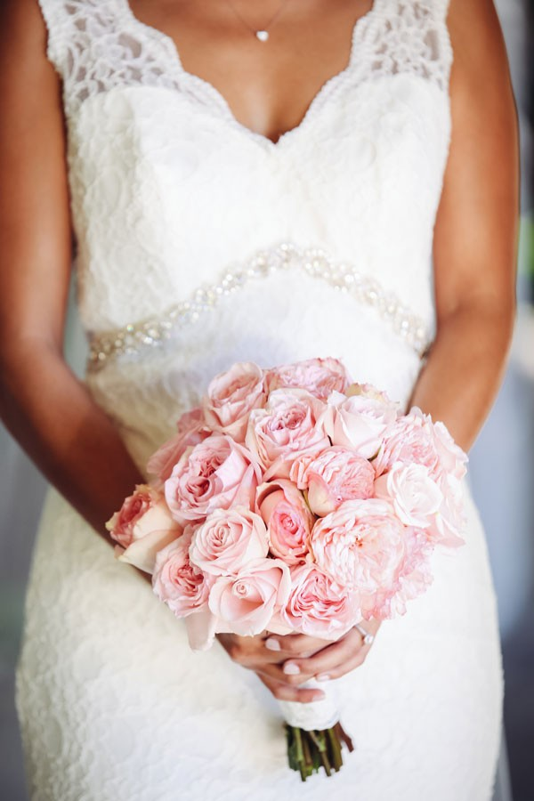 bride with pink rose bouquet