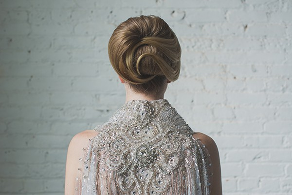 Beaded capelet on bride with elegant updo
