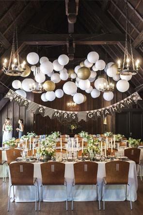 reception banner and hanging round white and gold paper lanterns
