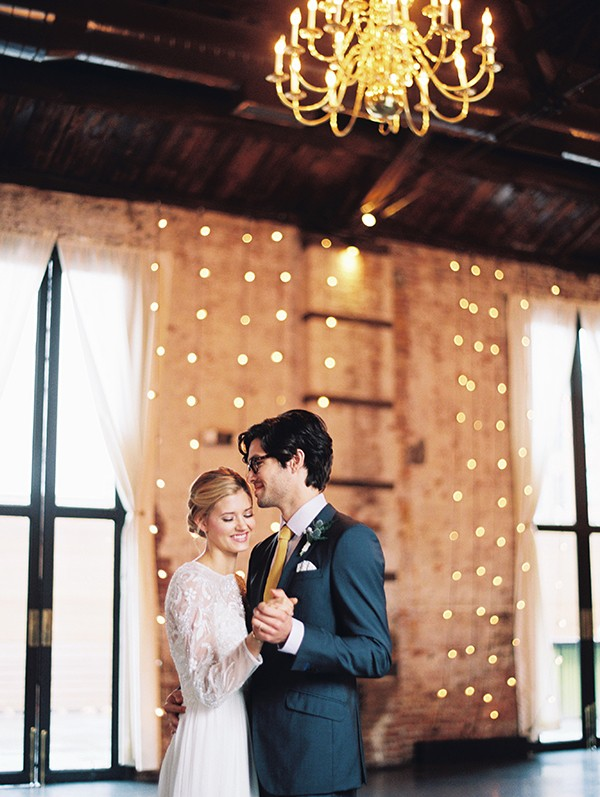 First dance with market lighting from mywedding magazine photo by Kate Ignatowski