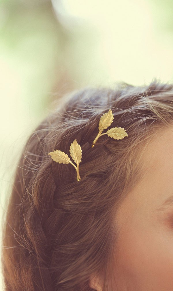 tiny golden leaf hair pins complementing a boho braid hairstyle