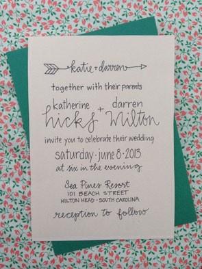 simple wedding invitation with cursive script and Cupid's arrow