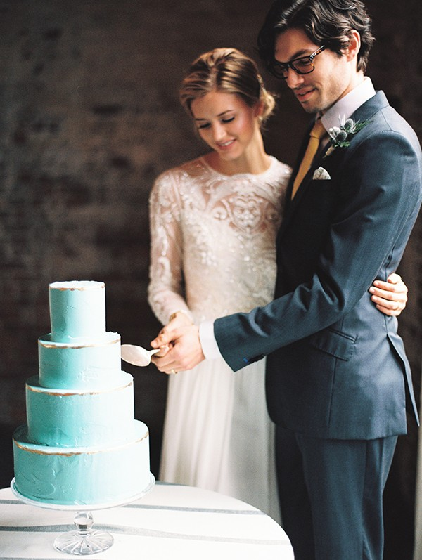bride and groom cutting the cake from mywedding magazine photo by Kate Ignatowski