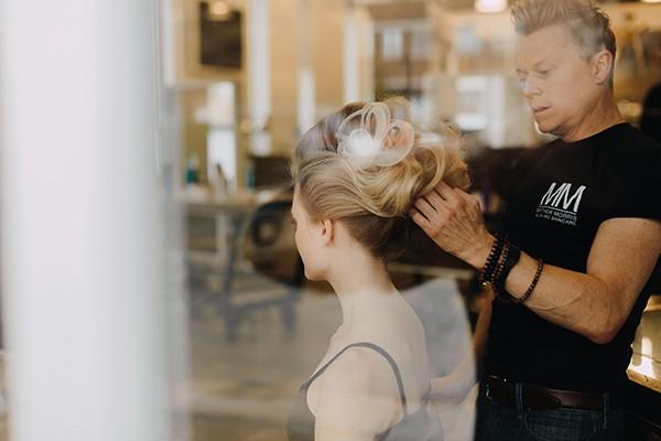 Matthew Morris creating a dramatic wedding hairstyle