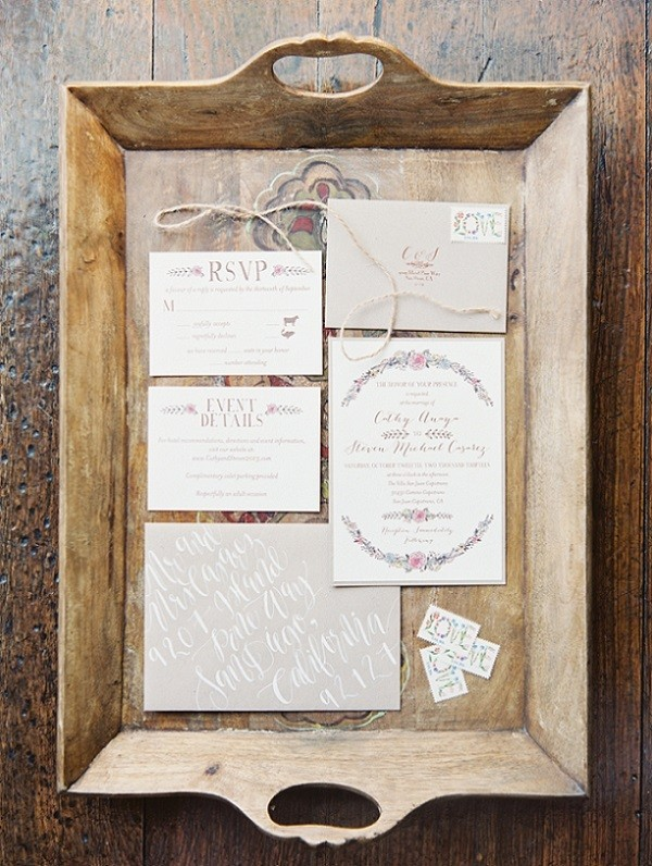 Rustic and vintage wedding invitation design with handwritten calligraphy.