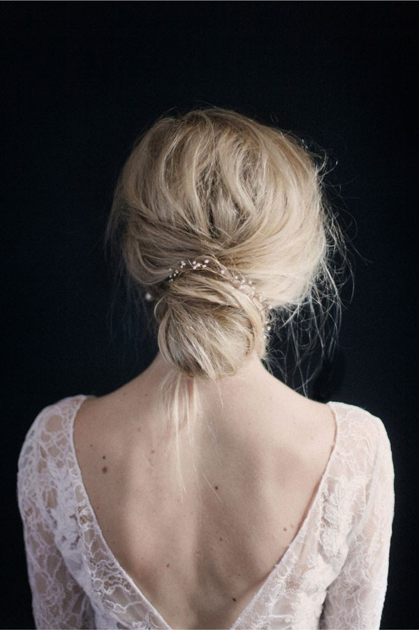 mother of pearl hair wrap tied around low chignon