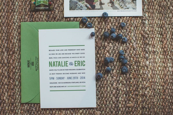modern wedding invitation in green and white with a blue ampersand
