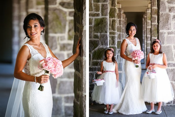 bride with pink rose bouquet and flower girls in white dresses with pink sashes