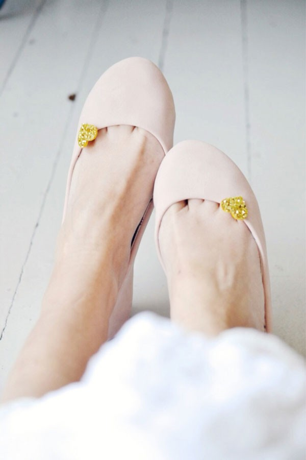 tiny and sparkly gold heart shoe clips worn with blush flats