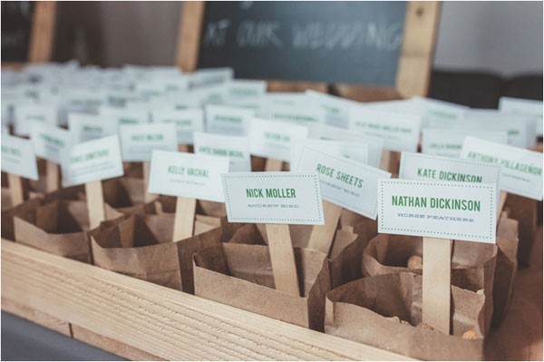 escort cards attached to paper bags filled with peanuts
