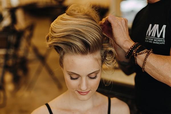 Matthew Morris sewing a wedding hairstyle