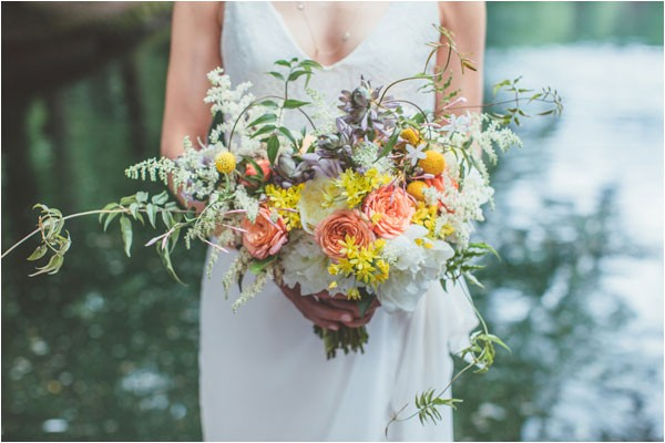 bridal bouquet with peach roses and button mums