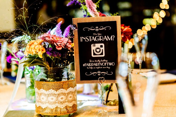 burlap and lace wrapped centerpieces with Instagram sign