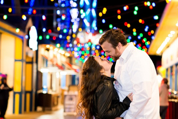 engaged couple kisses at Galveston carnival