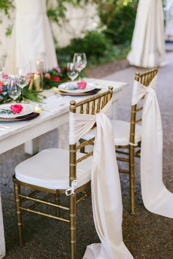 white sashes tied around tops of Chiavari chairs