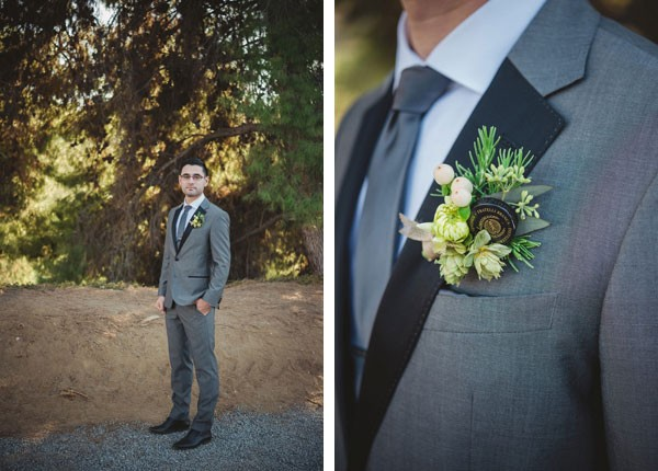 groom in gray suit with boutonniere with bottle cap