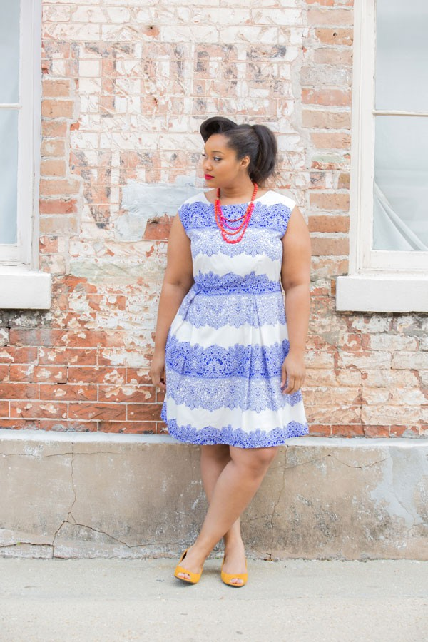 retro bridesmaid dress in blue and white styled with red necklace