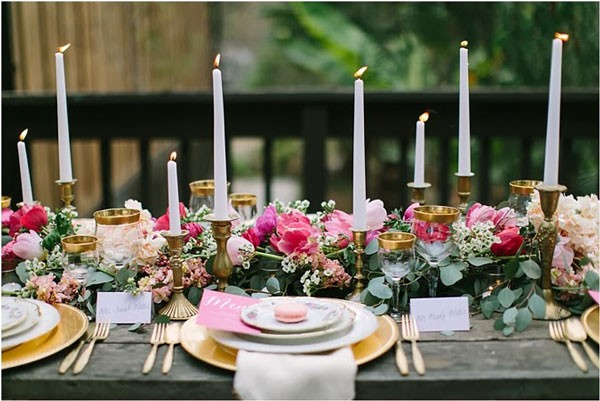 long reception centerpiece with pink flowers and gold accent details