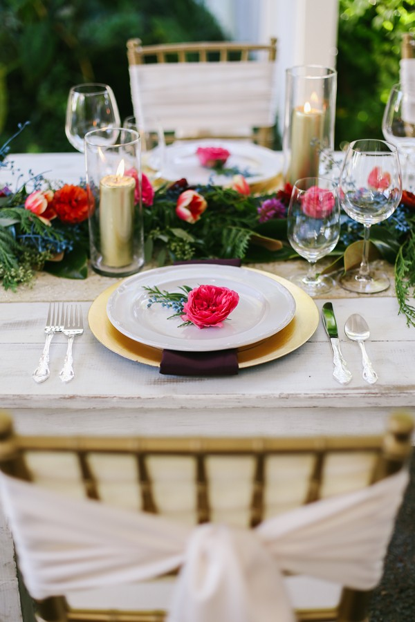 pink and gold place setting on vintage wedding tablescape