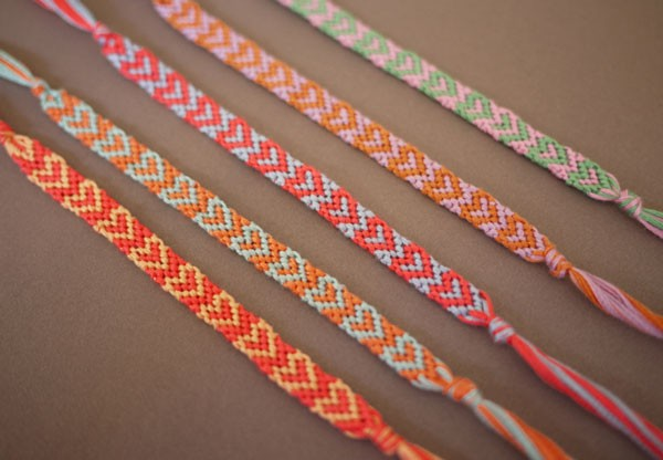 DIY friendship bracelets with heart pattern in sherbet shades