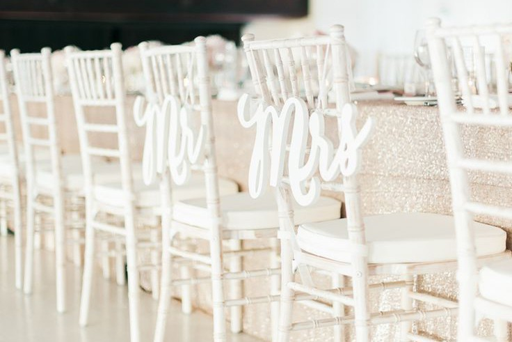 Monochromatic Mr. and Mrs. chair signs