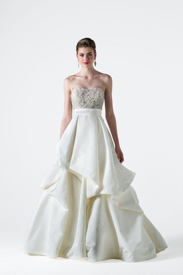 wedding dress with beaded bodice and full, layered ball gown skirt