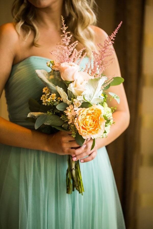 bridesmaid in strapless mint dress with pastel bouquet