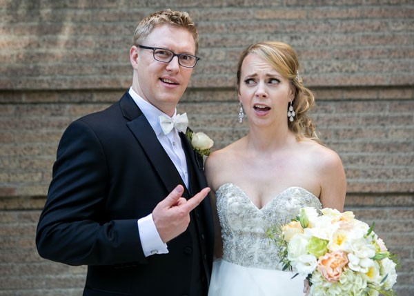 bride and groom goof off in front of the camera