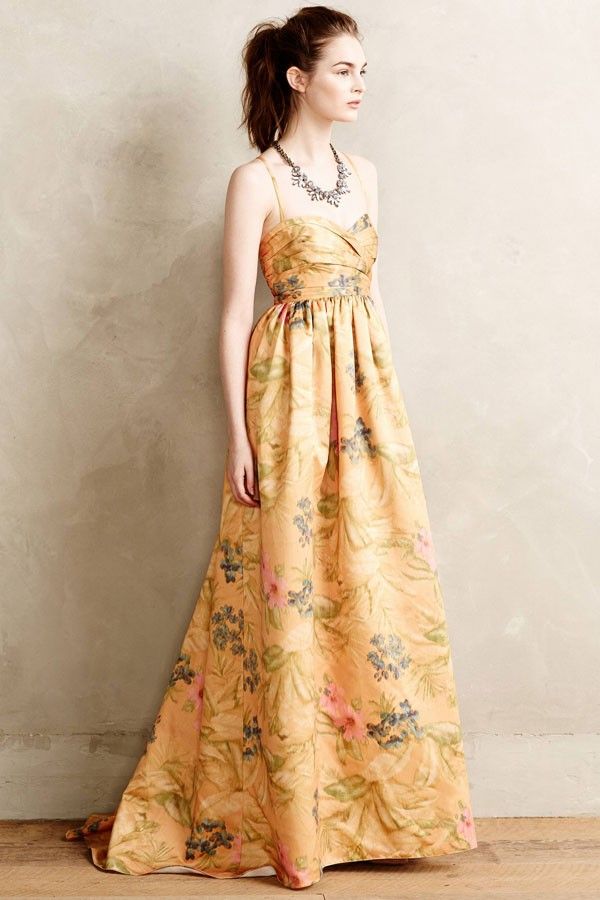 long bridesmaid dress with spaghetti straps and floral pattern in buttercup yellow