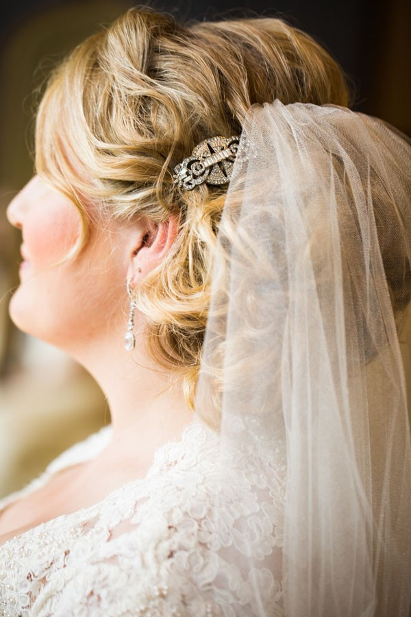 bridal updo with veil and sparkly hair clip