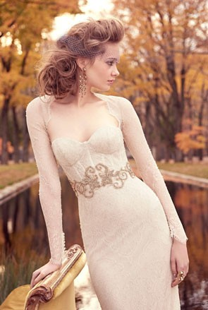 wedding dress with lingeri inspired bodiice and sheer sleeve cover up