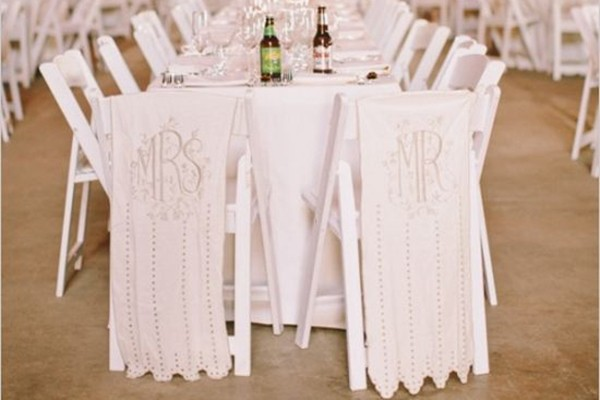 Elegant white wedding chair signs