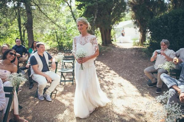bride with simple baby's breath bouquet