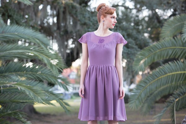 cap sleeved purple bridesmaid dress with updo